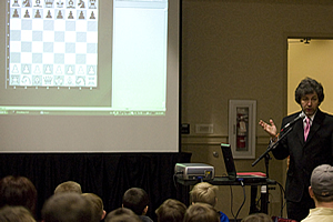 Gregory Kaidanov giving a chess lesson.